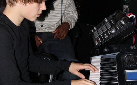 Young Justin B. playing keys